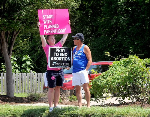 Opposing sides at a rally outside Planned Parenthood in Missouri - DON SHRUBSHELL/AP PHOTOS