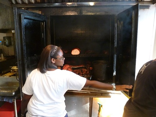 Opening the pit at L.C.'s BBQ in Kansas City - MICHAEL GEBERT