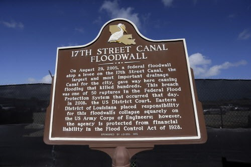 A historic marker for Hurricane Katrina on the 17th Street Canal in New Orleans - AP PHOTO/GERALD HERBERT
