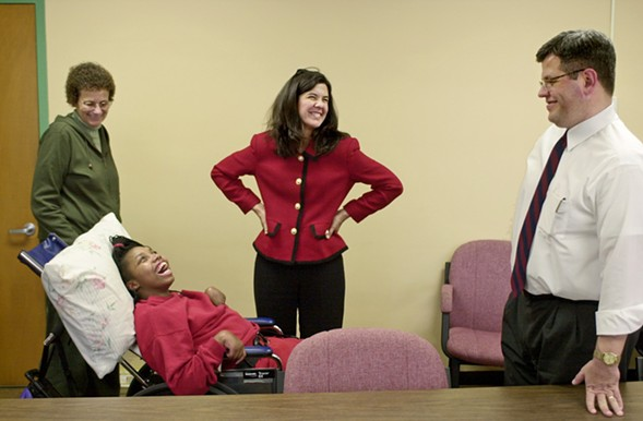 """Shatoya Currie, formerly known as """"Girl X,"""" with (left to right) speech therapist Barbara Robinson, Alvarez and former assistant state's attorney William O'Brien in 2002. Alvarez touts the conviction of Currie's assailant as a major achievement. - RICH HEIN/SUN-TIMES"""