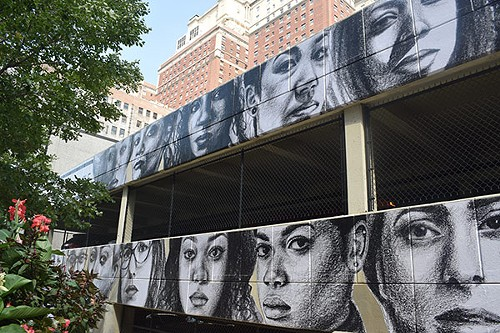 The mural peers out over the corner of Eighth and Wabash. - TATYANA FAZLALIZADEH