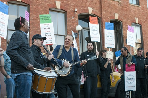 """A pro-union band cheekily calling themselves """"Chicago Federation of Musicians"""" entertain the rally. - ANDREA BAUER"""
