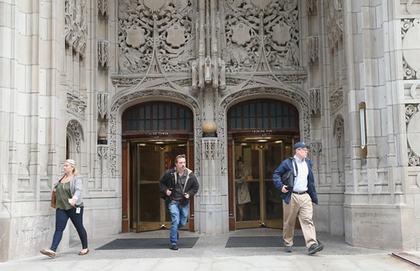 Tribune staffers prepare to exit the building. - SCOTT OLSON/GETTY IMAGES