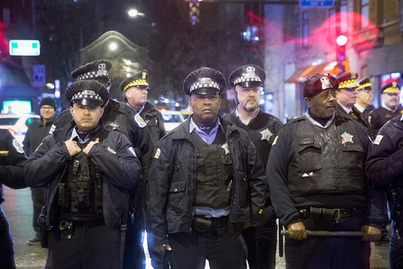 Chicago police stood guard Wednesday as demonstrators protested the death of Laquan McDonald. - SCOTT OLSON/GETTY IMAGES