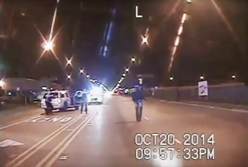 A frame from the dash-cam video of the fatal shooting of  Laquan McDonald. The 17-year-old, carrying a knife,  walks down Pulaski Road as officers Jason Van Dyke and Joseph Walsh train their guns on him. Moments later, Van Dyke, the officer on the right in this frame, opened fire on McDonald. - CHICAGO POLICE DEPARTMENT VIA AP, FILE