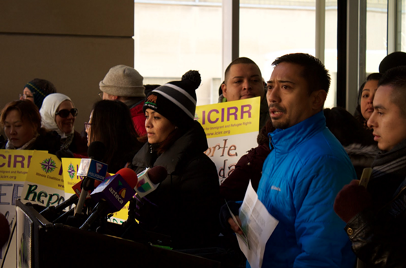 ICIRR CEO Lawrence Benito, right, called Tuesday for an extension of a program that would help prevent some deportations. - MANNY RAMOS