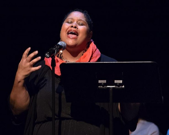 Poet Nikki Patin, pictured here at a 2014 event, gathered with other local spoken-word artists Monday to address the issue of sexual assault in their community. - MICHAEL COURIER