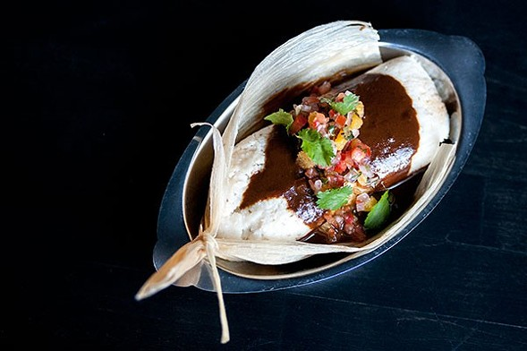 A tamal stuffed with duck confit and foie gras at Duck Inn, one of the participating restaurants - ANDREA BAUER