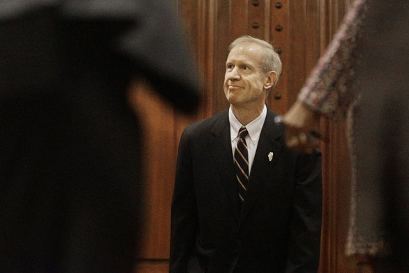 Governor Bruce Rauner waits to be announced before delivering his State of the State address. - AP/SETH PERLMAN