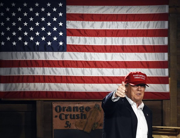 Donald Trump arrives onstage before speaking during a campaign stop in South Carolina. - AP/RAINIER EHRHARDT