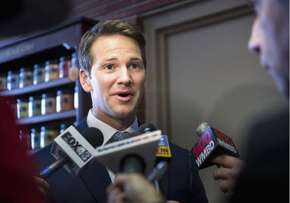 Aaron Schock speaks to the media in February 2015. - AP/JOURNAL STAR, FRED ZWICKY