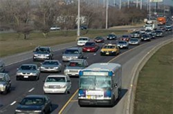 A Pace bus driving on the shoulder of the Stevenson. - PACE