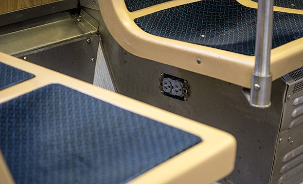 Older el cars feature an outlet located in each car under the aisle-facing seats closest to the semi-private corner opposite the enclosed booth intended for the train driver. - CHRIS RIHA