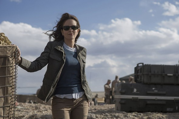 Tina Fey plays journalist Kim Baker, a fictionalized version of former Tribune reporter Kim Barker, in Whiskey Tango Foxtrot. - PARAMOUNT PICTURES