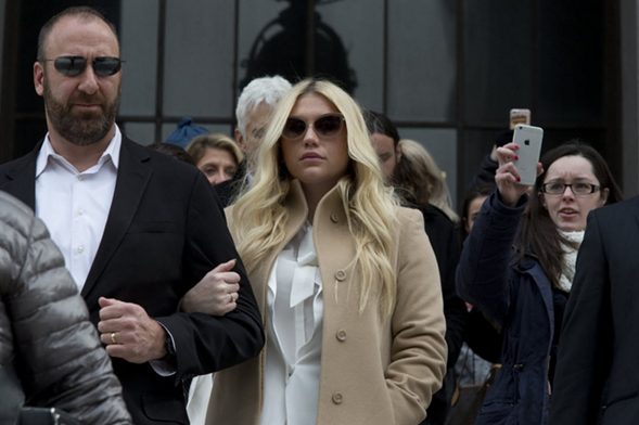 Kesha leaves the courthouse in New York Friday. - AP/MARY ALTAFFER