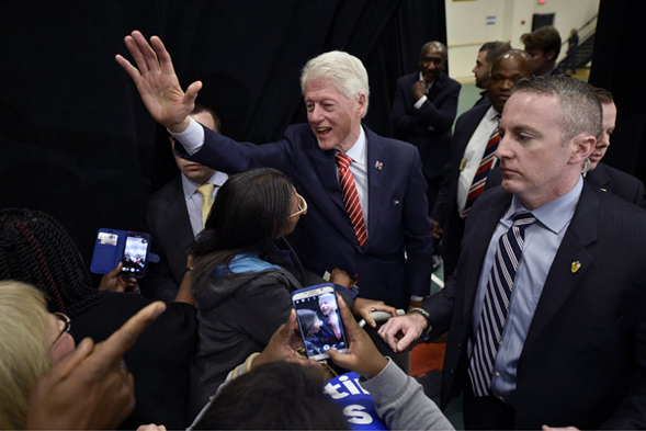 Former President Bill Clinton greets the crowd during a campaign stop for his wife, Democratic presidential candidate Hillary Clinton. - MICHAEL HOLAHAN/THE AUGUSTA CHRONICLE VIA AP