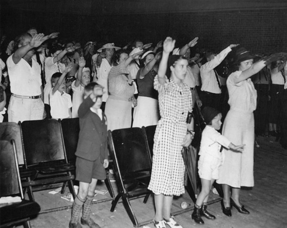 An audience gives the Hitler salute at the Bund headquarters in Kenosha, Wisconsin, in 1937. - SUN-TIMES