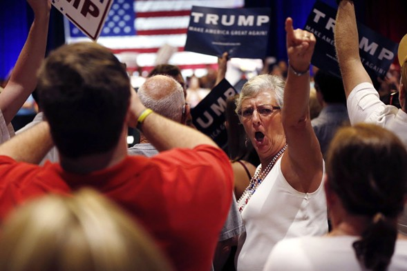 Trump supporters at a Tampa rally Sunday - AP PHOTO/GERALD HERBERT