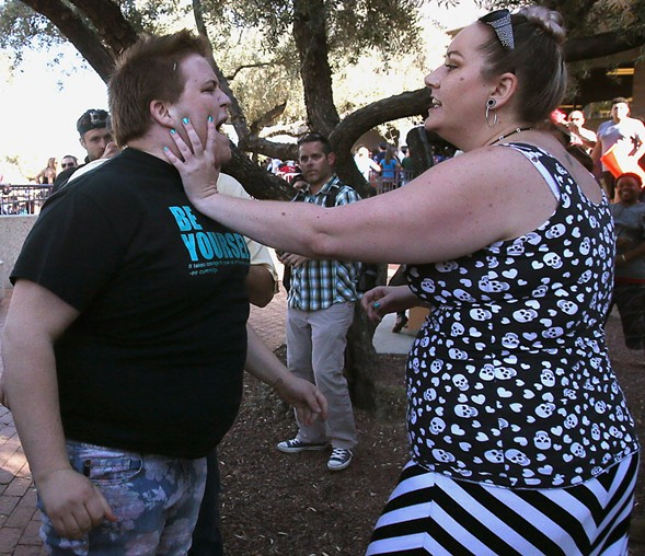 A protester and supporter get into an altercation at a Trump rally in Tucson Saturday. - MAMTA POPAT/ARIZONA DAILY STAR VIA AP