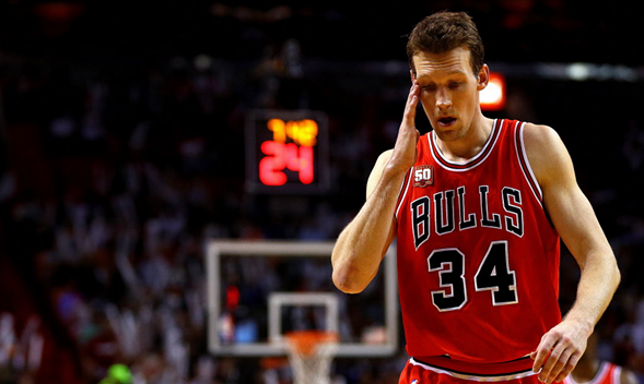 Chicago Bulls guard Mike Dunleavy averts his eyes during a game against the Miami Heat Thursday. - MIKE EHRMANN/GETTY IMAGES