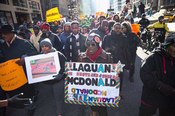 Demonstrators calling for an end to gun violence and the resignation of Mayor Rahm Emanuel march through downtown in December 2015. - SCOTT OLSON/GETTY IMAGES