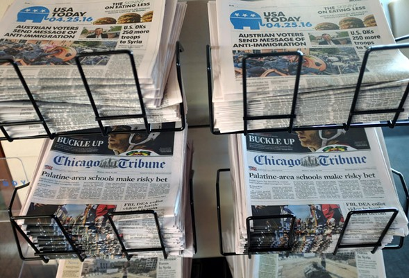 Newspaper publisher Gannett said Monday that it wants to buy Tribune Publishing for more than $388 million. - AP PHOTO/KIICHIRO SATO