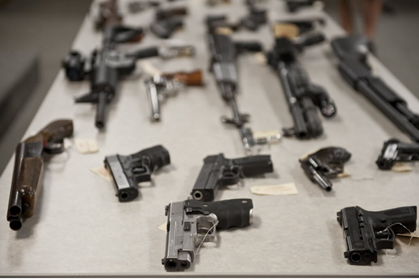 Some of the guns confiscated by the Chicago Police Department in 2012 - RICH HEIN/SUN-TIMES