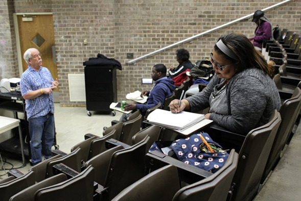 Robert Bionaz, an associate professor of history at Chicago State University, lectures during a class in April. - AP PHOTO/DAVID MERCER