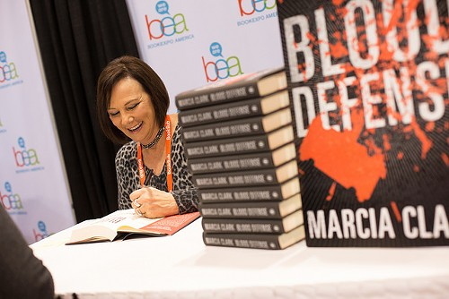 Marcia Clark signs copies of her new book, Blood Defense. - COURTESY BEA