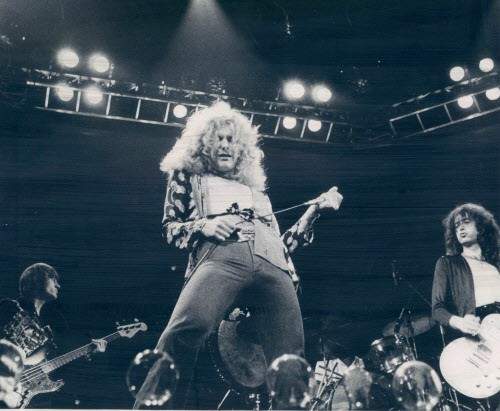 Led Zeppelin in 1976, with Robert Plant in the middle of a very nonyoga pose - SUN-TIMES MEDIA ARCHIVE