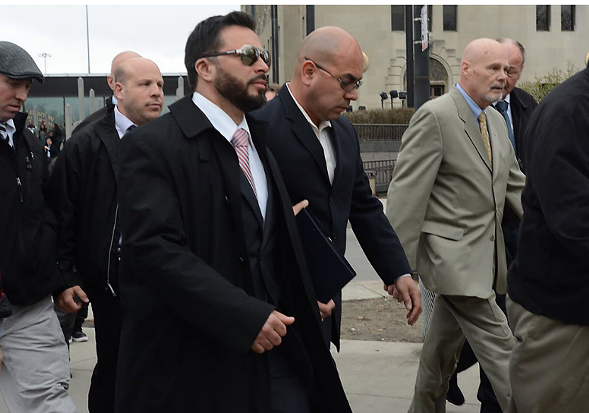 Chicago police officer Dante Servin, in sunglasses, leaves court at 26th and California after being found not guilty of involuntary manslaughter in 2015. - BRIAN JACKSON/FOR SUN-TIMES MEDIA
