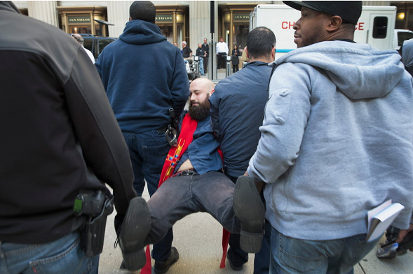 A demonstrator protesting the state of Illinois budget stalemate is carried away by police after being arrested at the Chicago Board of Trade building in November. - SCOTT OLSON/GETTY IMAGES