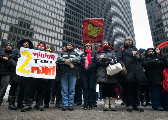 Activists in Federal Plaza call for an end to deportations in 2014. - PETER HOLDERNESS / SUN-TIMES