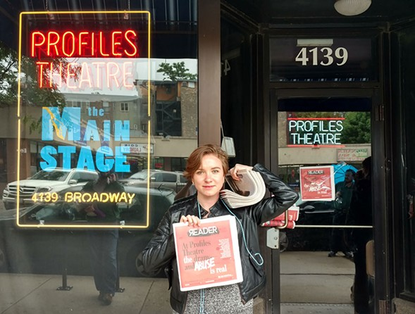 Couling in front of the theater's front door, where someone had already taped a copy of the paper. - EILEEN TULL