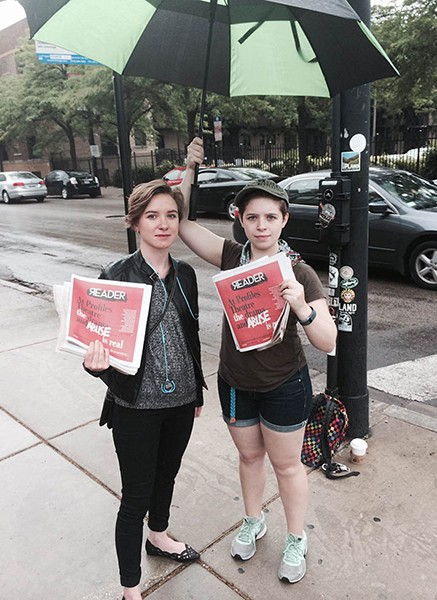 Emma Couling and Gaby Labotka protest conditions at Profiles Theatre by handing out copies of the Reader. - CHRISTOPHER PIATT