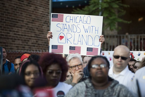 Chicagoans held vigil Sunday for the victims of the Orlando shooting. - ASHLEE REZIN/SUN-TIMES