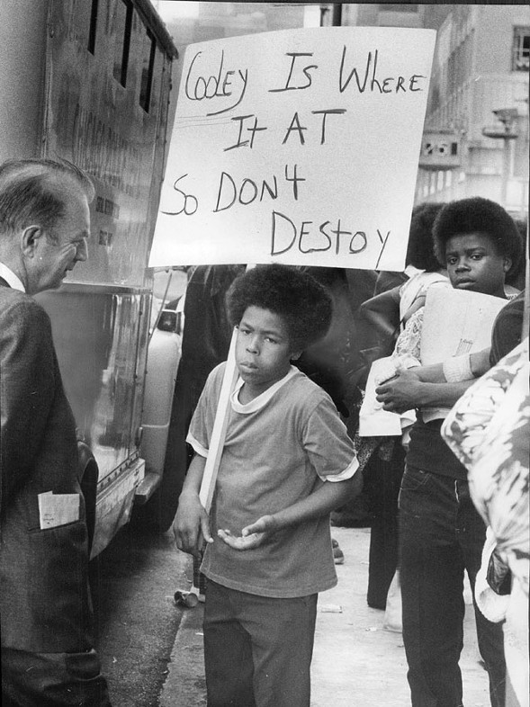 A student pickets the Board of Education headquarters Tuesday protesting teacher cuts at Cooley High School in 1974 - FRED STEIN/SUN-TIMES PRINT COLLECTION