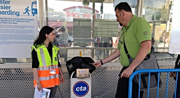 Tapping a Ventra card on the portable reader to enter the paid waiting area. - JOHN GREENFIELD