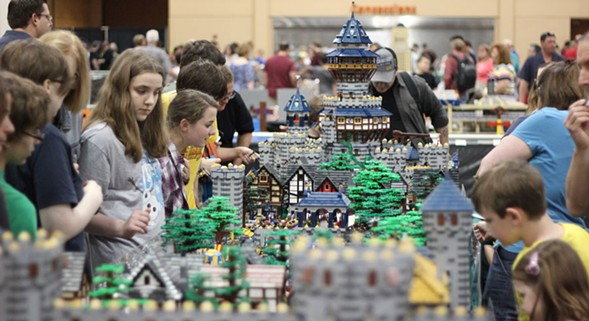 Brickworld features giant Lego displays, like this one: a 20-foot-long medieval market and castle. - BRYAN BONAHOOM