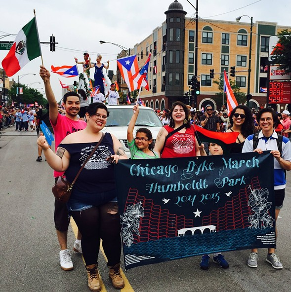From left: Benji Hart, Mayadet Patitucci Cruz, and others march in the 2015 Puerto Rican People's Parade. - JJ UEUNTEN