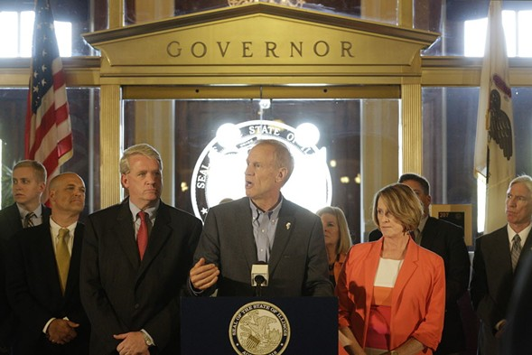 Governor Bruce Rauner and lawmakers announce a stopgap budget deal in Springfield Thursday. - AP PHOTO/SETH PERLMAN