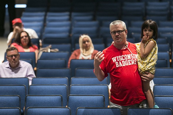 Richard Myers holds his five-year-old daughter, Sophia, as he asks a question during a discussion about lead testing in Chicago Public Schools in June. - ASHLEE REZIN/SUN-TIMES