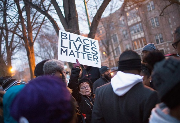 Demonstrators protest outside of Mayor Rahm Emanuel's home on December 29, 2015. - SCOTT OLSON/GETTY IMAGES