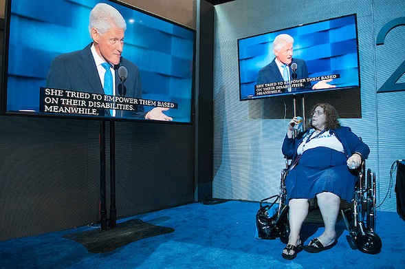 Former President Bill Clinton on screen at the DNC