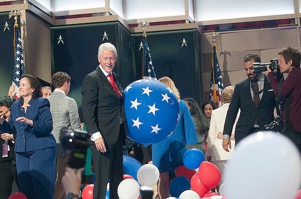BIll Clinton surrounded by balloons at the Wells Fargo Center