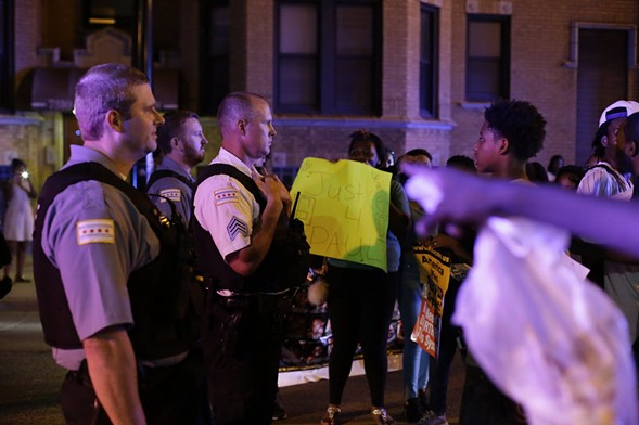 Demonstrators confronted police officers Friday as they protested the fatal police shooting of Paul O'Neal last month. - PHOTO BY JOSHUA LOTT/GETTY IMAGES