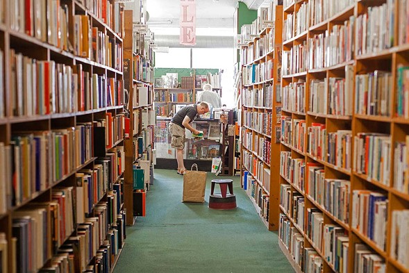 A customer browses Bookworks' extensive collection of titles. - DANIELLE A. SCRUGGS