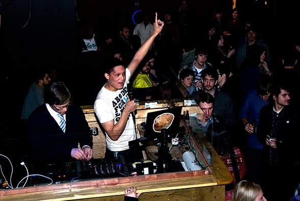 """Mig Reyes, center, at the Merge party at Evil Olive in February 2010. Performances such as this would no longer be considered """"music"""" under the current reading of Cook County standards. - CHRIS GALLEVO"""