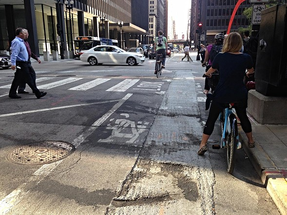 Lousy pavement in the Dearborn two-way protected bike lane. - JOHN GREENFIELD