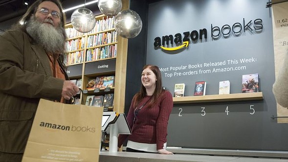 Customers shop at the Amazon Books store in Seattle—also coming soon to Lakeview. - JASON REDMOND, AFP/GETTY IMAGES